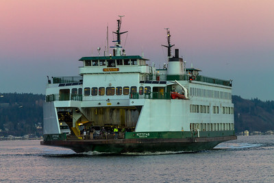 The M/V Kittitas steams into port as the sun begins to rise in Puget Sound