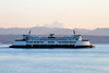 A Washington State Ferry crosses in front of Mount Baker in Washington State