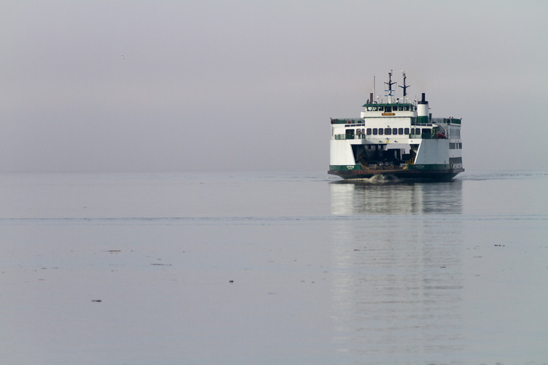 The M/V Kittitas emerges from fog while crossing from Whidbey Island to Mukilteo - Washington