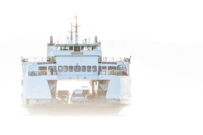 The ferry boat Kittitas approaches a dock in a high key photograph