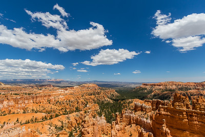 Wide view of Bryce Canyon National Park with a few clouds and shadows on the land