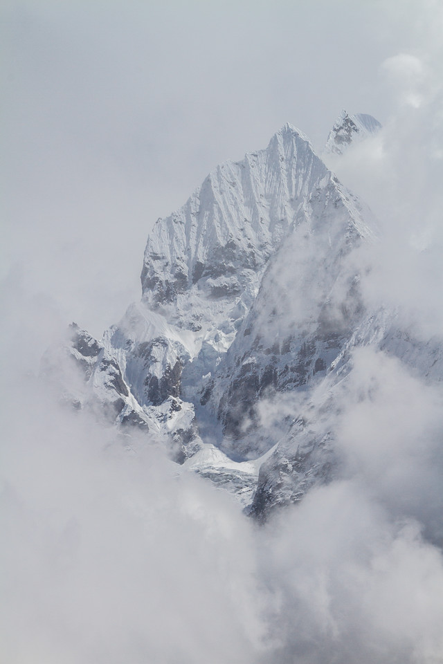 Himalayas through swirling mystical swirling clouds, Nepal