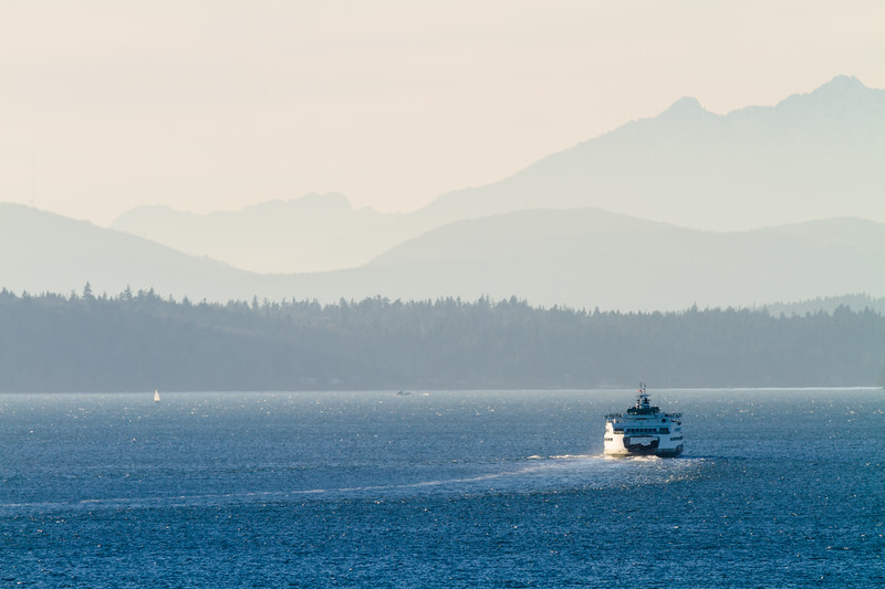 Passenger ferry at sea and mountains in background - USA - Washington - Seattle