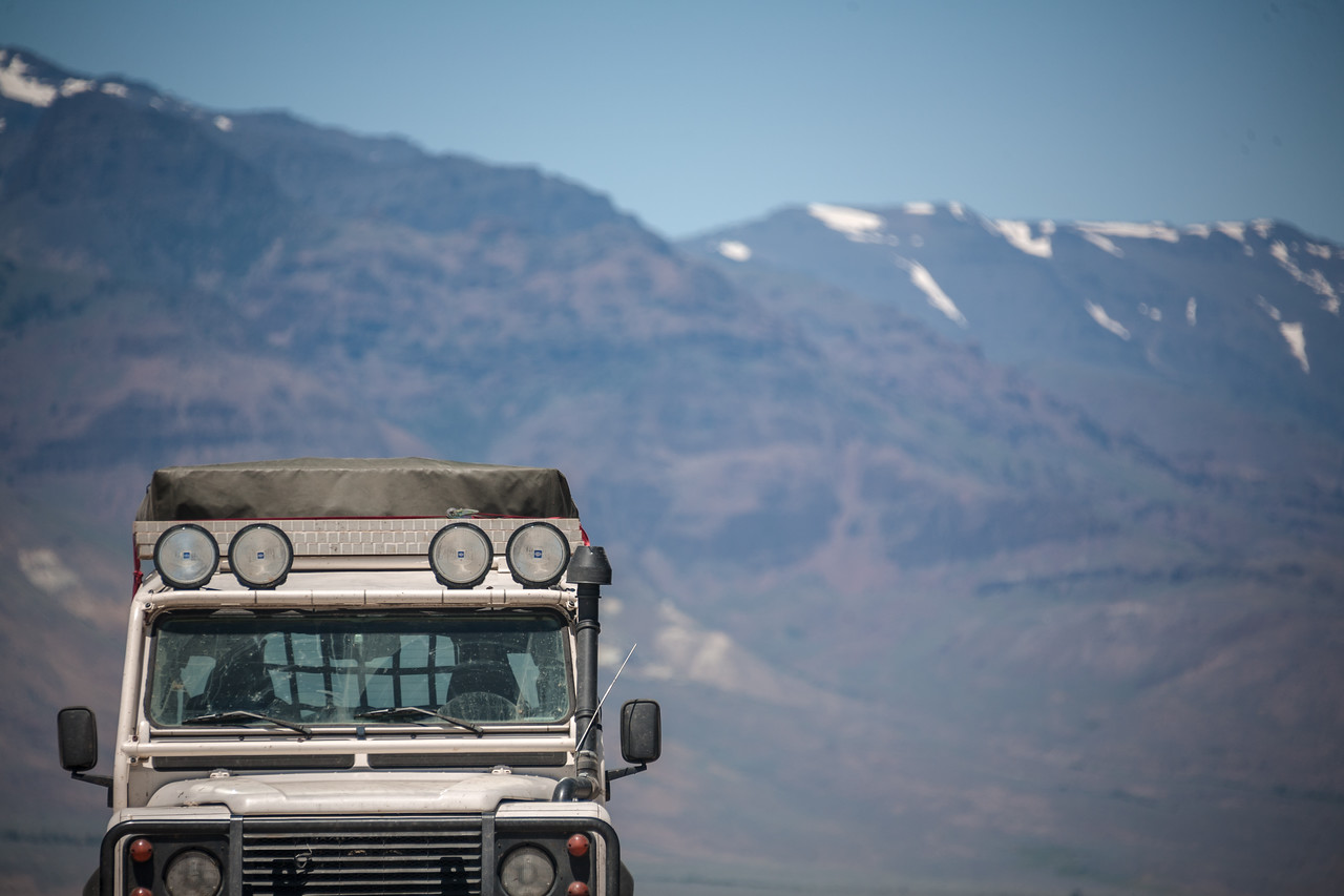 Landrover Defender NAS 110 offroad vehicle in front of mountas at Alvord Desert, Oregon, USA