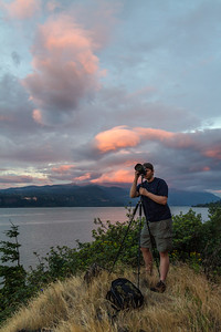 Man taking photographs near Columbia River - Oregon - USA