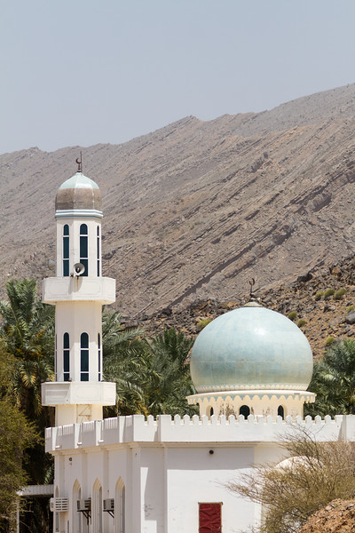 View of mosque with mountain in background - Oman