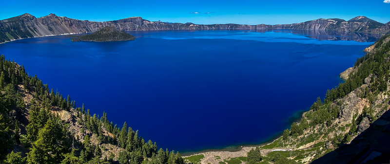 Panorama view of Crater Lake's deep blue waters in Southern Oregon