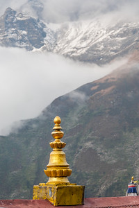 View of chorten with snowcapped mountain in background