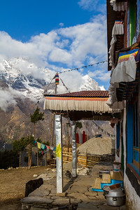 View of temple with snowcapped mountain in background - Nepal