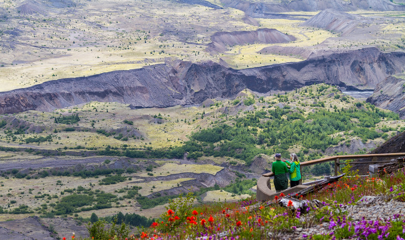 Two tourists look over the area ofdevestation caused by Mt. St. Helens - Washington - USA