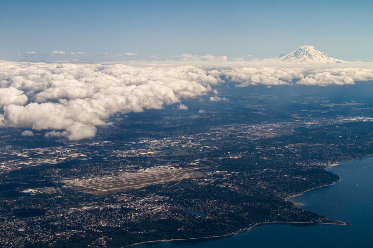 SeaTac Airport, Mount Rainier and the Puget Sound with a cloud layer on a sunny day, Washington, USA