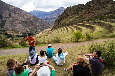 Tourists sitting at Machu Picchu - Cusco Region - Peru