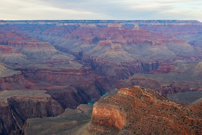 View of the Grand Canyon and a bit of the Colorado River in Grand Canon National Park, Arizona, USA near sunset