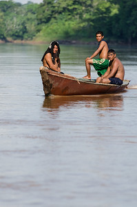 Mens travelling in boat - Peru
