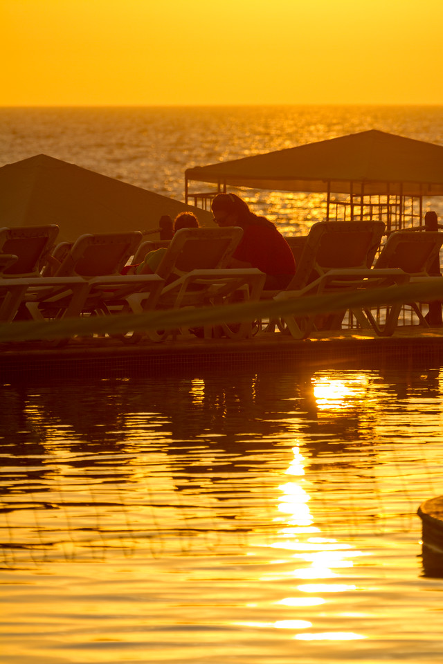 People relaxing on lounge chair on jetty - Mexico - Puerto Vallarta