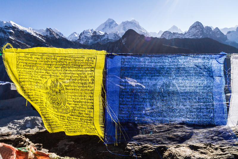Yellow And Blue Buddhist Prayer Flags In Front Of Mount Everest, Nuptse And Makalu From Gokyo Ri, Himalayas, Nepal