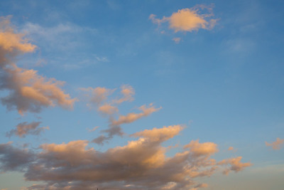 Slightly orange clouds and blue sky at sunset over Los Angeles