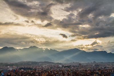 Cityscape with mountains and cloudy sky - Nepal