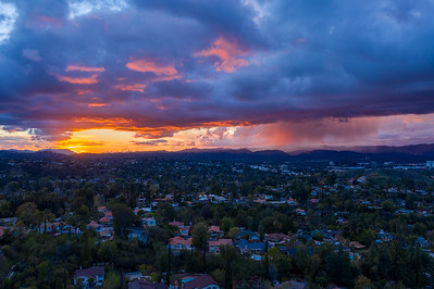 Sunset and storm clouds are colored purple and orange over the San Fernando Valley - Woodland Hills, Los Angeles, California, United States (US)