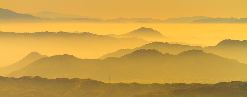 Sunset on layers of mountains extending into the distance - California - USA