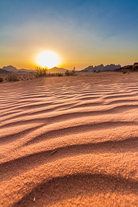 View of sunset with rippled sand in foreground - Jordan - Wadi Rum