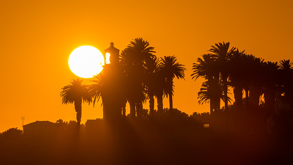 The sun sets over Point Vicente Lighthouse along California's Coast