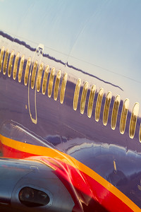 Exterior of a Southwest Airlines plane while reflecting a sunset at Orange County/Santa Ana Airport