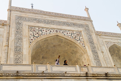 People standing at gateway to Taj Mahal - India
