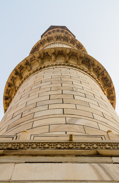 One of the minarets of the Taj Mahal as seen from the ground looking up.