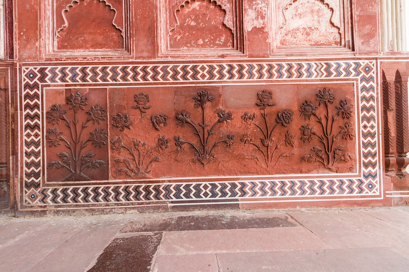 Scroll work in the red sandstone of the Jawab at the Taj Mahal