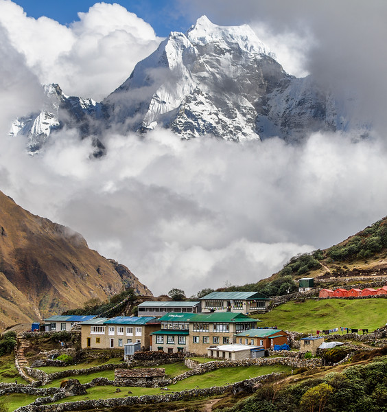 The Village Of Dole Sits Below A Bank Of Clouds And Kangtega, Nepal