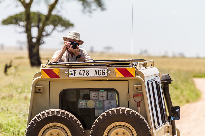 Tourist taking photographs in national park - East Africa - Tanzania
