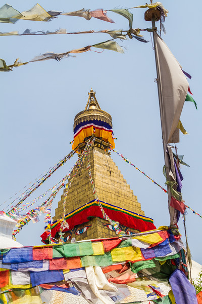 View of Boudhanath stupa with prayer flags - Nepal