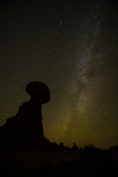 The Milky Way is seen off to the side of Balanced Rock in Arches National Park, Utah