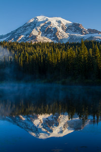 Mount Rainier in Washington state is reflected in appropriately named Reflection Lakes. Part of the larger and active volcanic range known as the Cascade Mountains, the peak is the highest i ...