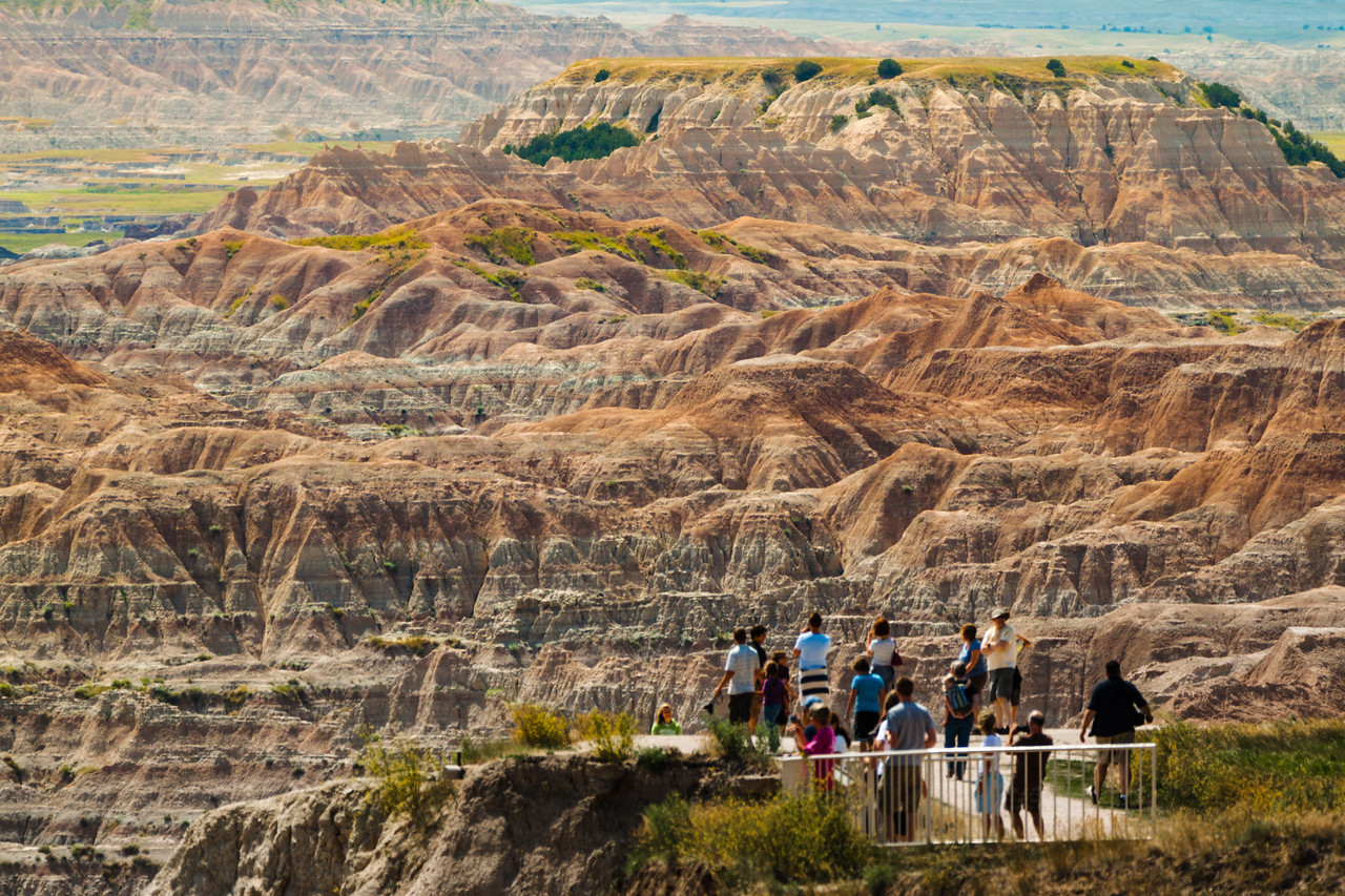 Shot July 20, 2009 - RAW file available - Badlands National Park by Peter West Carey - Visitors at an overlook take in the colors of Badlands National Park in South Dakota
