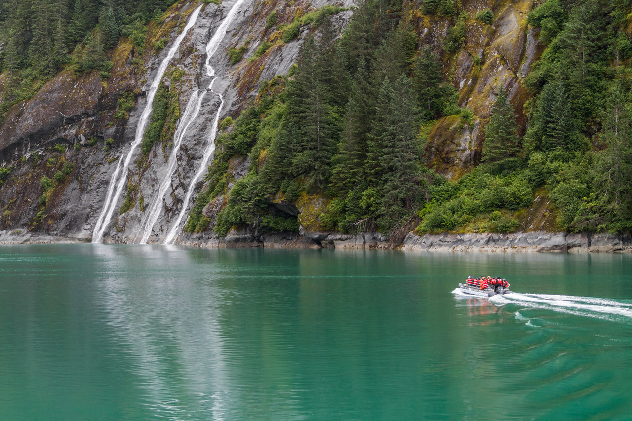Tourist in cruise ship skiff touring waterfall - Tracy Arm - Alaska