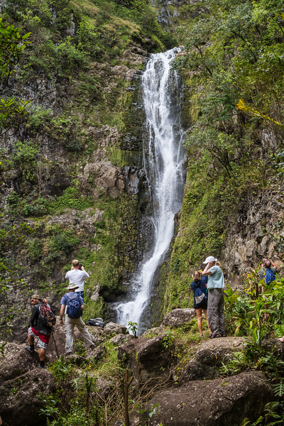 Tourists standing at waterfall - USA - Hawaii