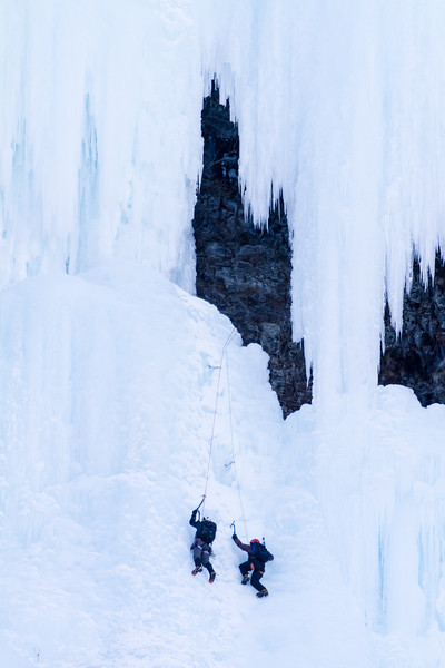 Ice climbers above Lake Louise attempt to scale a frozen waterfall