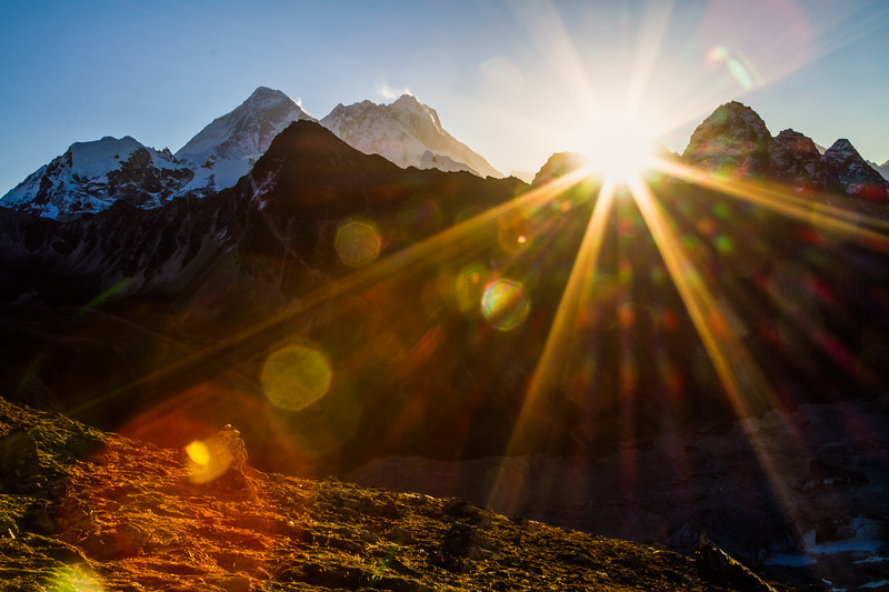 The sun comes up over Makalu and just to the side of Mount Everest and Nuptse, as seen from Gokyo Ri, Nepal