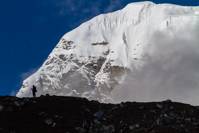 Photographer Silhouetted Against Cho Oyu, Nepal