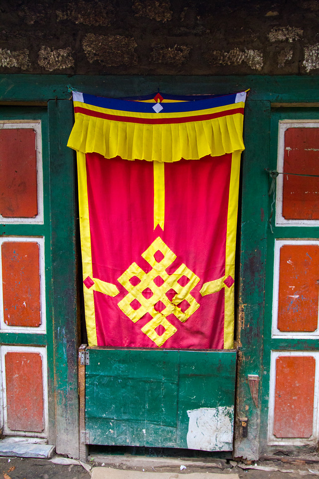 Sherpa door coverings hang in the town of Namche Bazaar, Solukhumbu District, Nepal. The designs are based on Tibetan Buddhism.