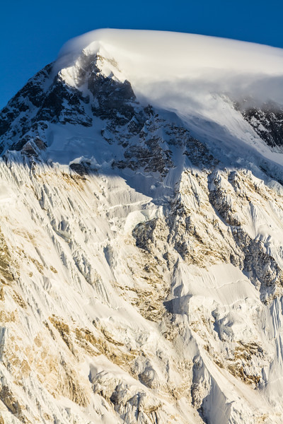 Wind swept clouds form at the top of Cho Oyu, the sixth highest mountain in the world, Himalayas, Nepal