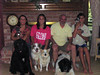 Sailor was adopted by OWNC members and fit right in with their menagerie of animals. What a wonderful family portrait! Too bad the two cats, nine birds, and rabbit couldn't fit in the picture.
