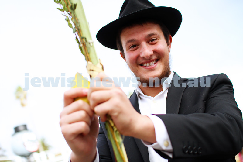 13-10-14. Chabad Youth's annual Succot celebration at Luna Park. Shaking the lulav and etrog. Photo: Peter Haskin