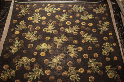 This is a sample piece of black silk. I used a make up sponge to dab on the gold dots and then used one of my home made foam stamps for the leaves. The Lumiere paints work very well for this black silk. The pattern shows on both sides.