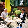 Mummy and Daddy having lunch in the courtyard.