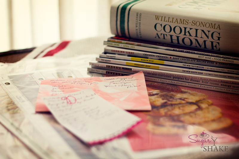 Menu planning: piles of clippings, cookbooks and magazines to sort through (this is just a tiny fraction of what Sugar has accumulated over the years), with some of Sugar's menus and grocery lists. © Sugar + Shake