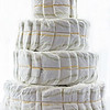 Stacked and ready for decorating. Optionally, you can build the layers around a central pole if you want to keep the whole thing steadier. © 2014 Sugar + Shake
