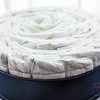 This is a spiral-style cake, rather than the roll-and-pack-style. Using a cake pan to start the layer makes things easier. © 2014 Sugar + Shake
